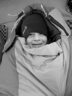kid in sleeping bag